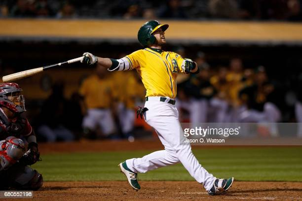 Jed Lowrie of the Oakland Athletics hits a walkoff home run during the eleventh inning against the Los Angeles Angels of Anaheim at the Oakland...