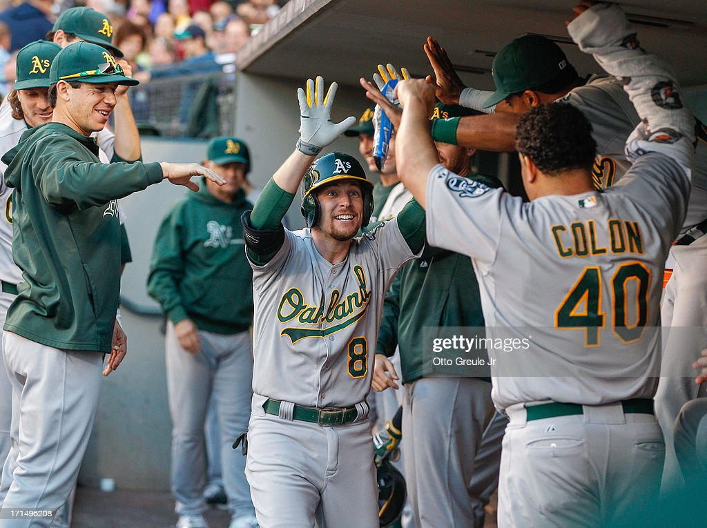 <a gi-track='captionPersonalityLinkClicked' href=/galleries/search?phrase=Jed+Lowrie&family=editorial&specificpeople=4949369 ng-click='$event.stopPropagation()'>Jed Lowrie</a> #8 of the Oakland Athletics is congratulated by teammates after hitting a home run in the fourth inning against the Seattle Mariners at Safeco Field on June 21, 2013 in Seattle, Washington.