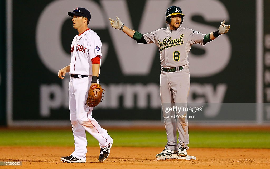 <a gi-track='captionPersonalityLinkClicked' href=/galleries/search?phrase=Jed+Lowrie&family=editorial&specificpeople=4949369 ng-click='$event.stopPropagation()'>Jed Lowrie</a> #8 of the Oakland Athletics reacts at second base after hitting what was called a foul ball in the ninth inning against the Boston Red Sox during the game on April 24, 2013 at Fenway Park in Boston, Massachusetts.