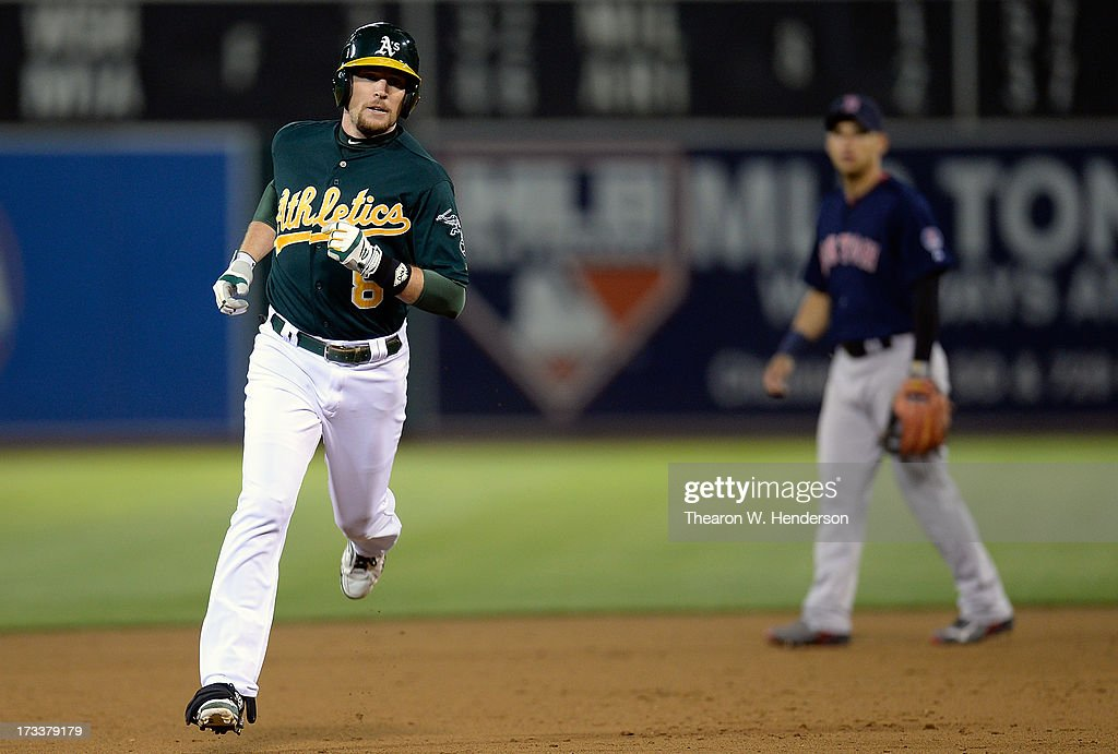Jed Lowrie #8 of the Oakland Athletics rounds the bases after hitting a solo home run in the sixth inning against the Boston Red Sox at O.co Coliseum on July 12, 2013 in Oakland, California.