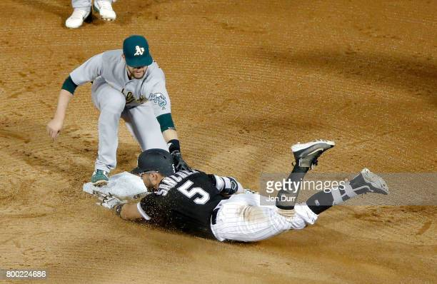 Jed Lowrie of the Oakland Athletics tags out Yolmer Sanchez of the Chicago White Sox as he attempted to reach second base after hitting a single...