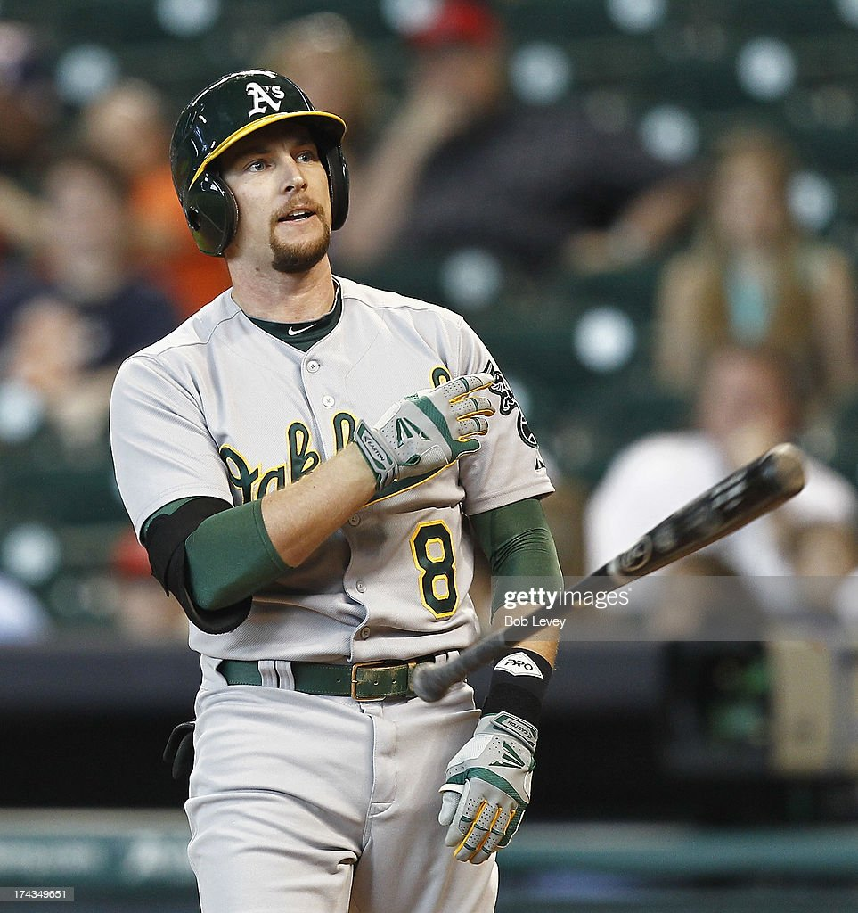 Jed Lowrie #8 of the Oakland Athletics throws his bat after striking out against the Houston Astros at Minute Maid Park on July 24, 2013 in Houston, Texas.