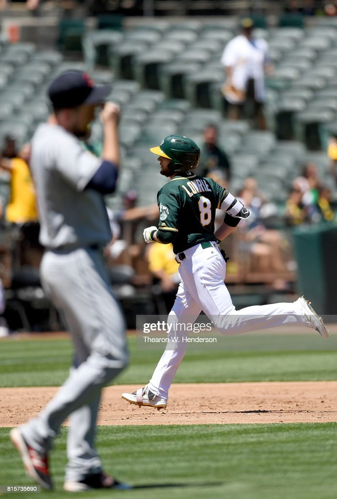 Jed Lowrie #8 of the Oakland Athletics trots around the bases after hitting a solo home run off of Dan Otero #61 of the Cleveland Indians in the bottom of the third inning at Oakland Alameda Coliseum on July 16, 2017 in Oakland, California.