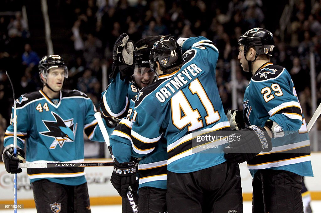 <a gi-track='captionPersonalityLinkClicked' href=/galleries/search?phrase=Jed+Ortmeyer&family=editorial&specificpeople=213278 ng-click='$event.stopPropagation()'>Jed Ortmeyer</a> #41 of the San Jose Sharks is congratulated by teammates after he made a goal on the Buffalo Sabres to give the Sharks a 4-2 lead in the third period at HP Pavilion on January 23, 2010 in San Jose, California.