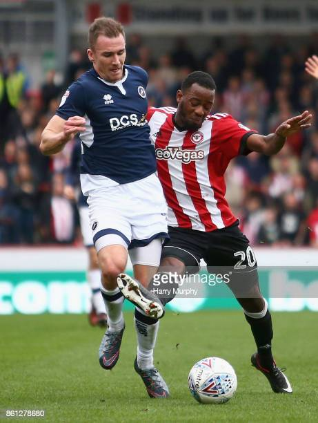 Jed Wallace of Millwall and Josh Clarke of Brentford battle for possession during the Sky Bet Championship match between Brentford and Millwall at...