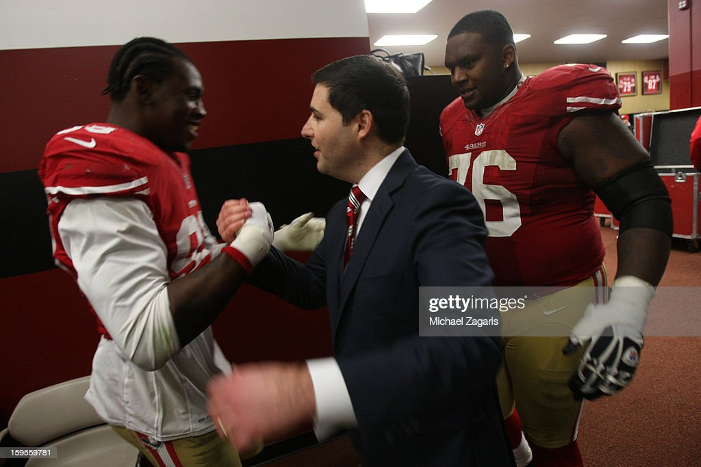 CEO Jed York of the San Francisco 49ers congratulates Aldon Smith #99 and Anthony Davis #76 in the locker room following the game against the Green Bay Packers at Candlestick Park on January 12, 2012 in San Francisco, California. The 49ers defeated the Packers 45-31.