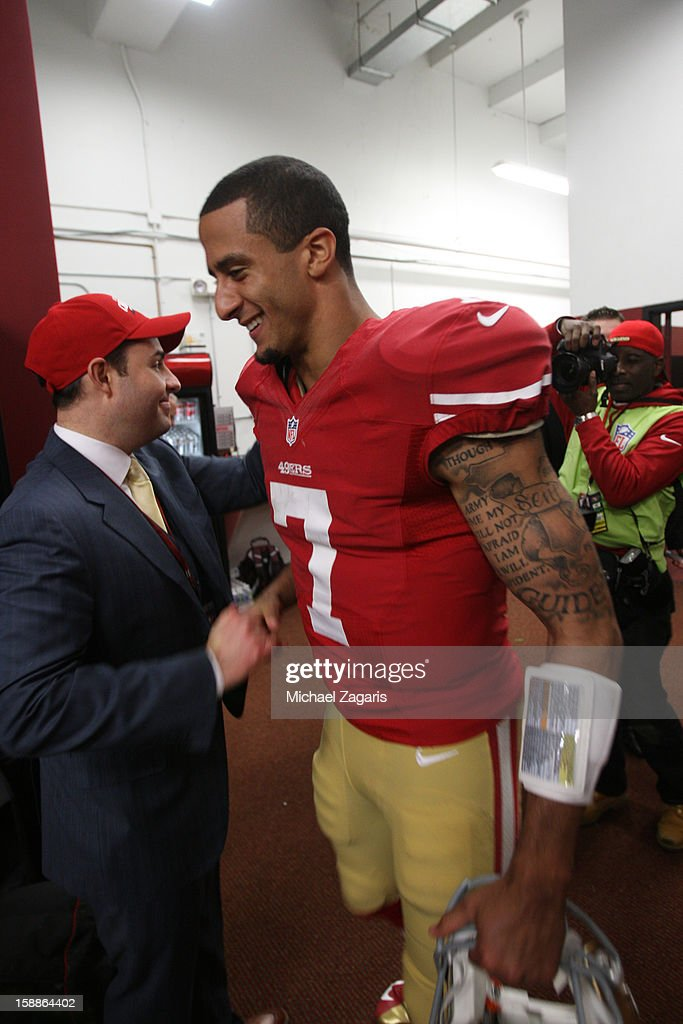 CEO Jed York of the San Francisco 49ers congratulates Colin Kaepernick #7 in the locker room following the game against the Arizona Cardinals at Candlestick Park on December 30, 2012 in San Francisco, California. The 49ers defeated the Cardinals 27-13.