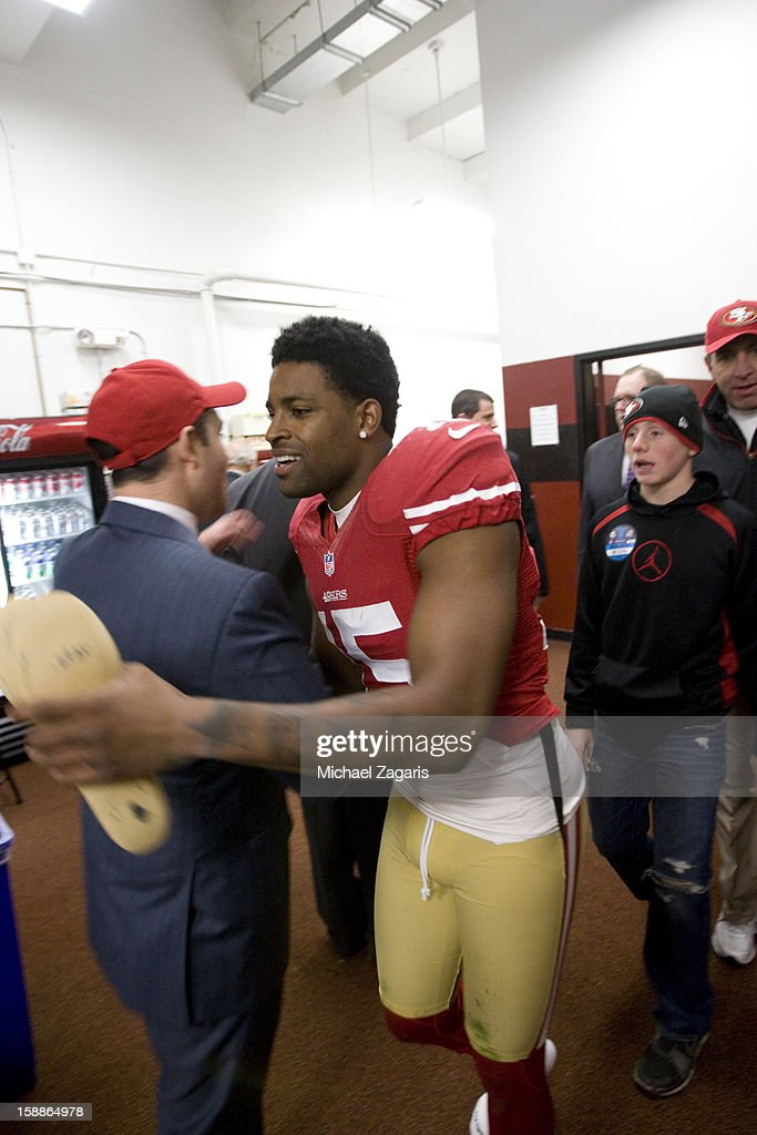 CEO Jed York of the San Francisco 49ers congratulates Michael Crabtree #15 in the locker room following the game against the Arizona Cardinals at Candlestick Park on December 30, 2012 in San Francisco, California. The 49ers defeated the Cardinals 27-13.
