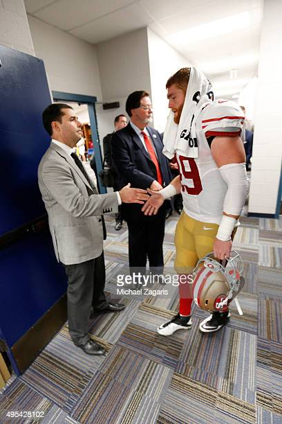 Jed York of the San Francisco 49ers greets Bruce Miller at the locker room following the game against the St Louis Rams at the Edward Jones Dome on...