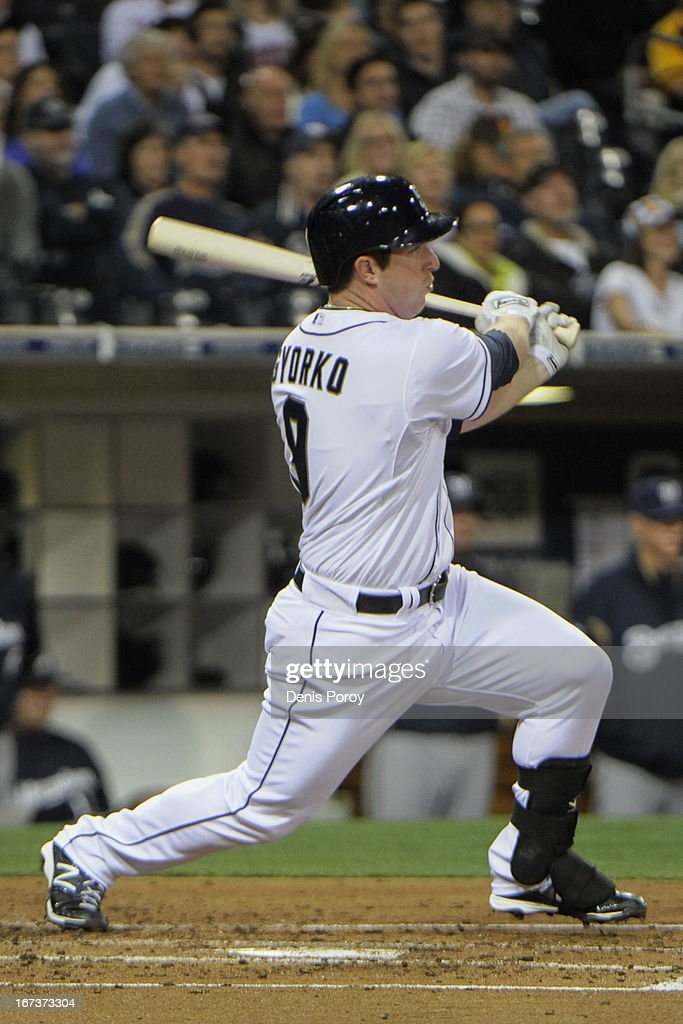 Jedd Gyorko #9 of the San Diego Padres hits a single during the second inning of a baseball game against the Milwaukee Brewers at Petco Park on April 24, 2013 in San Diego, California.