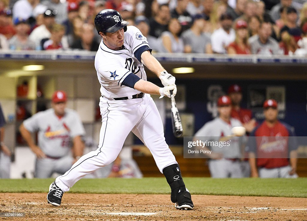 Jedd Gyorko #9 of the San Diego Padres hits a single during the sixth inning of a baseball game against the St. Louis Cardinals at Petco Park July 30, 2014 in San Diego, California.