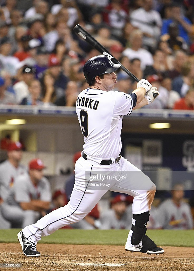 Jedd Gyorko #9 of the San Diego Padres hits a three RBI double during the seventh inning of a baseball game against the St. Louis Cardinals at Petco Park July 30, 2014 in San Diego, California.