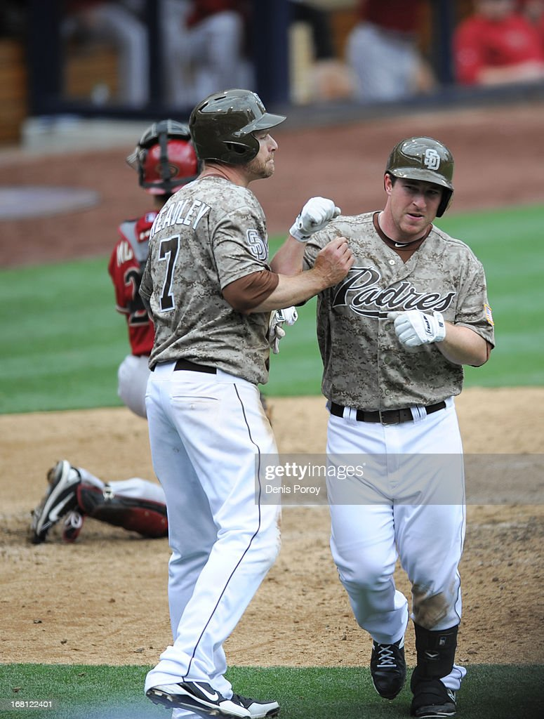 <a gi-track='captionPersonalityLinkClicked' href=/galleries/search?phrase=Jedd+Gyorko&family=editorial&specificpeople=8830434 ng-click='$event.stopPropagation()'>Jedd Gyorko</a> #9 of the San Diego Padres is congratulated by <a gi-track='captionPersonalityLinkClicked' href=/galleries/search?phrase=Chase+Headley&family=editorial&specificpeople=4353228 ng-click='$event.stopPropagation()'>Chase Headley</a> #7 after he hit a two-run homer during the sixth inning of a baseball game against the Arizona Diamondbacks at Petco Park on May 5, 2013 in San Diego, California. The Padres won 5-1.