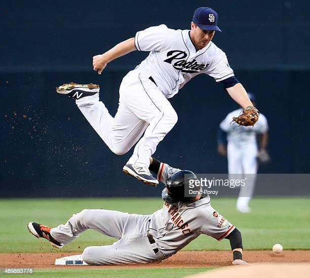 Jedd Gyorko of the San Diego Padres jumps for a high throw as Matt Duffy of the San Francisco Giants steals second base during the first inning of a...