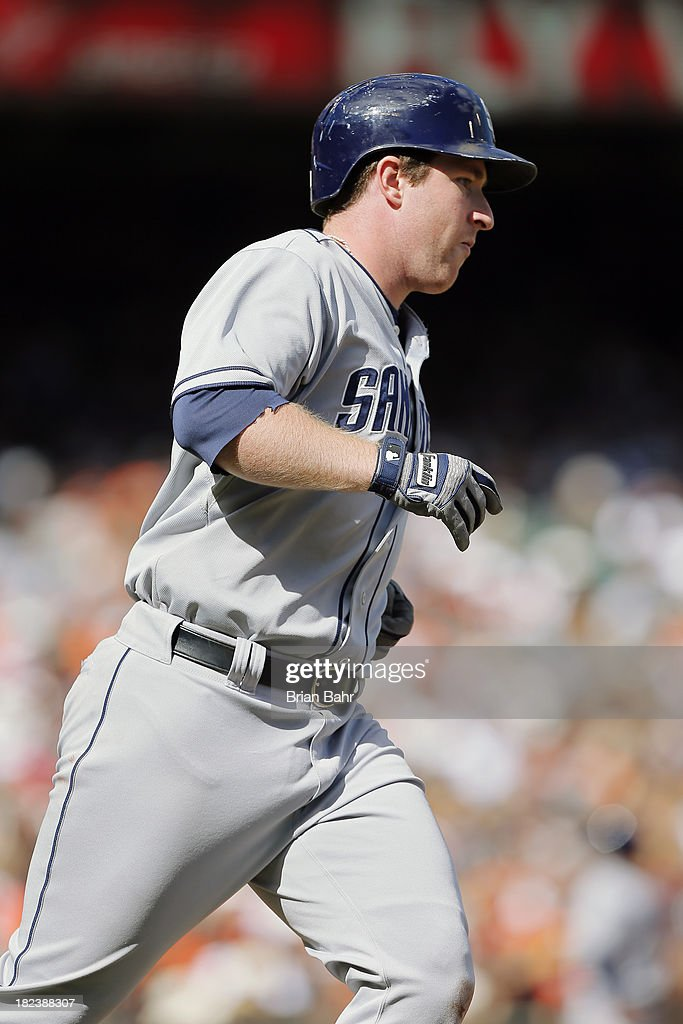 <a gi-track='captionPersonalityLinkClicked' href=/galleries/search?phrase=Jedd+Gyorko&family=editorial&specificpeople=8830434 ng-click='$event.stopPropagation()'>Jedd Gyorko</a> #9 of the San Dieigo Padres rounds first base after hitting a grand slam on a pitch from reliever Jake Dunning #51 of the San Francisco Giants in the fifth inning at AT&T Park on September 29, 2013 in San Francisco, California. The slam was Gyorko's 23rd home run of his rookie season.