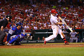 Jedd Gyorko of the St Louis Cardinals hits a gametying solo home run against the Los Angeles Dodgers in the ninth inning at Busch Stadium on July 22...