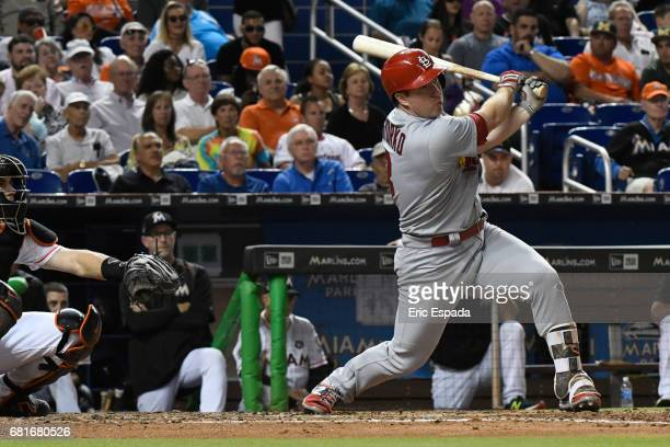 Jedd Gyorko of the St Louis Cardinals hits an RBI single in the 3rd inning against the Miami Marlins at Marlins Park on May 10 2017 in Miami Florida
