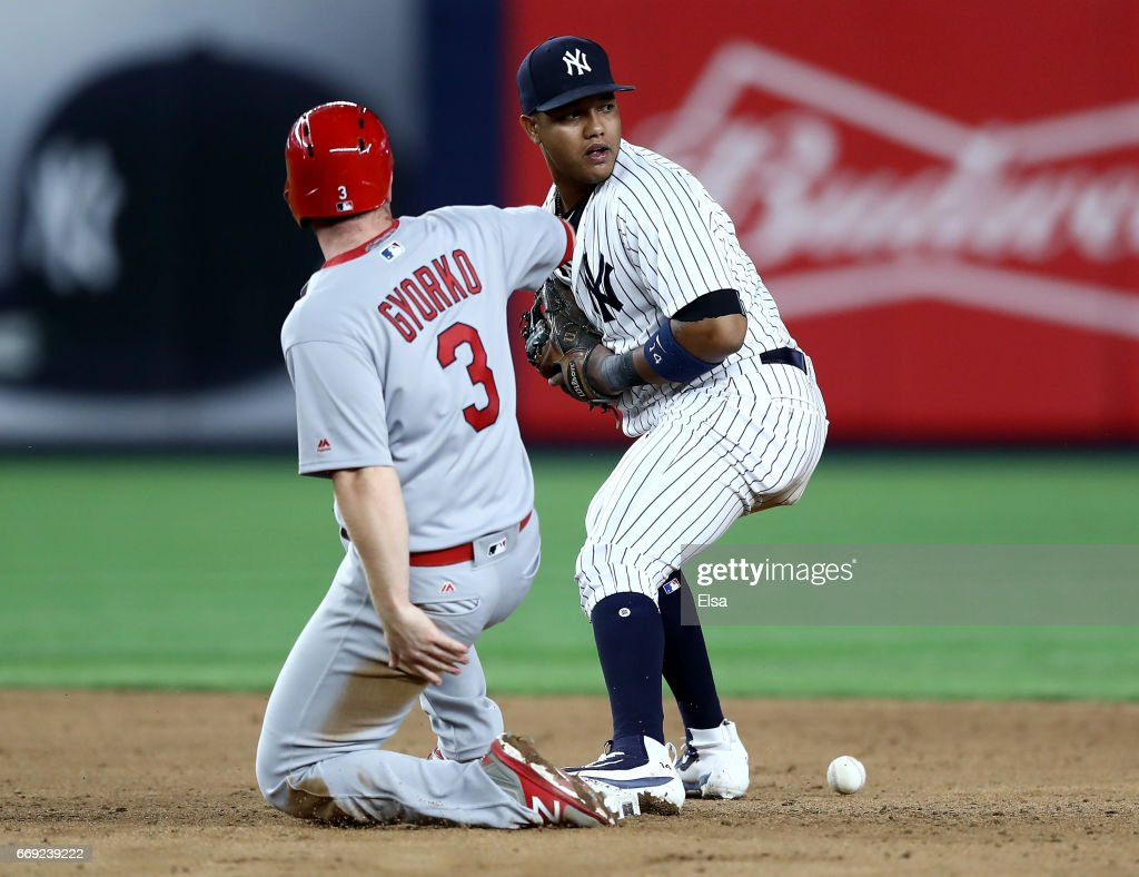 Jedd Gyorko #3 of the St. Louis Cardinals reaches third on an error as Starlin Castro #14 of the New York Yankees is unable to catch the ball in the ninth inning on April 16, 2017 at Yankee Stadium in the Bronx borough of New York City.