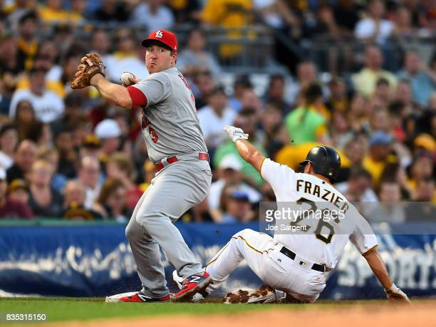 Jedd Gyorko of the St Louis Cardinals turns a double play in front of Adam Frazier of the Pittsburgh Pirates during the second inning at PNC Park on...