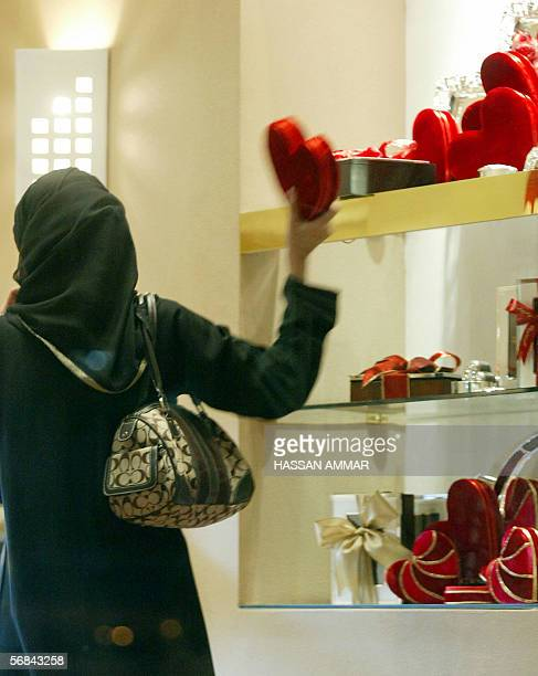 A Saudi woman checks chocolate for Valentine's day at a store in the Saudi Red Sea port of Jeddah 14 Febreary 2006 People around the world celebrate...