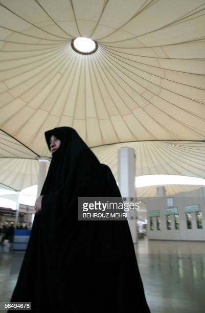 An Iraqi Muslim woman arrives at the King Abdul Aziz airport in the Red Sea port city of Jeddah 28 December 2005 The Muslim pilgrims arrive in Saudi...