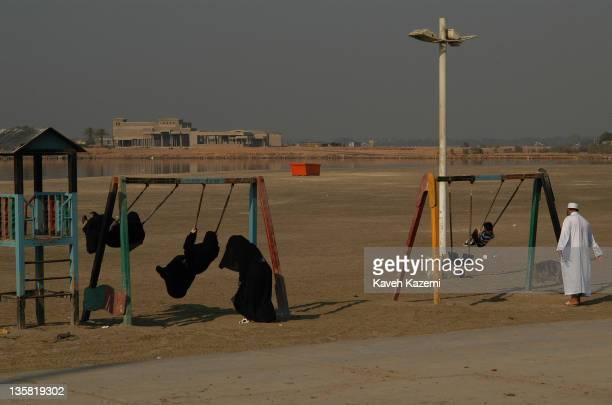 Saudi women swing on the corniche in Jeddah Saudi Arabia 3rd December 2005