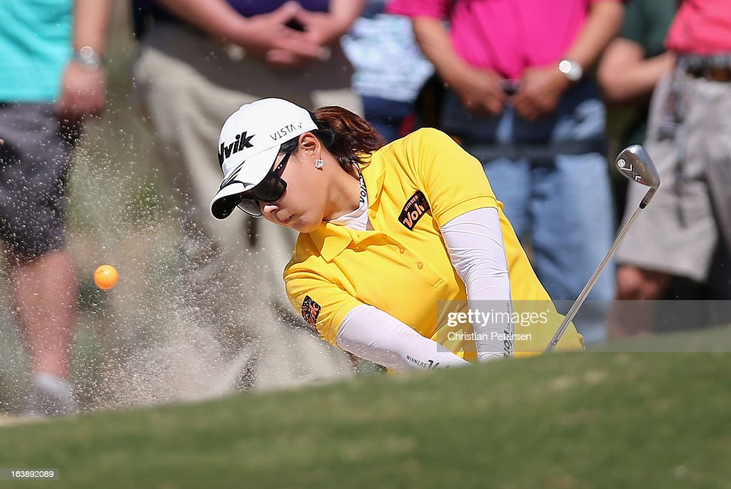 Jee Young Lee of South Korea chips from the bunker onto the fifth hole green during the final round of the RR Donnelley LPGA Founders Cup at Wildfire Golf Club on March 17, 2013 in Phoenix, Arizona.