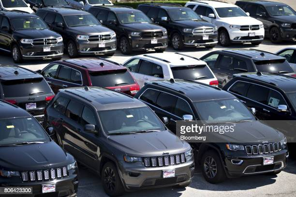 Jeep and Dodge vehicles are displayed for sale at a Fiat Chrysler Automobiles car dealership in Moline Illinois US on Saturday July 1 2017 Ward's...