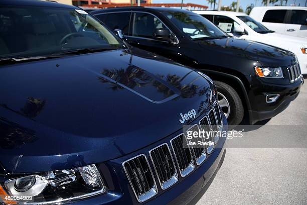 Jeep Cherokees are seen on a sales lot on April 2 2014 in Miami Florida Chrysler Group LLC announced it is recalling 867795 Jeep Grand Cherokee and...
