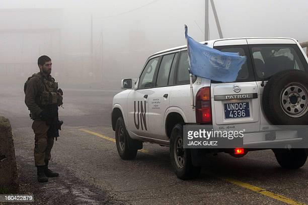 Jeep crosses the border between Israel and Syria on January 31 2103 a day after an overnight Israeli strike in the LebanonSyria border area Iran's...