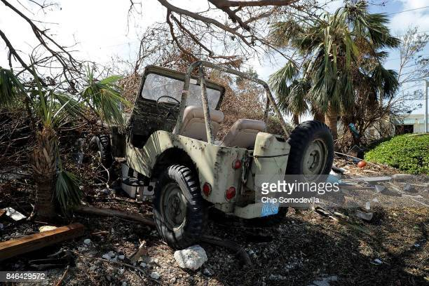 A jeep destroyed by hurricane storm surge water sits in a yard two days after Hurricane Irma slammed into the state on September 12 2017 in Marathon...