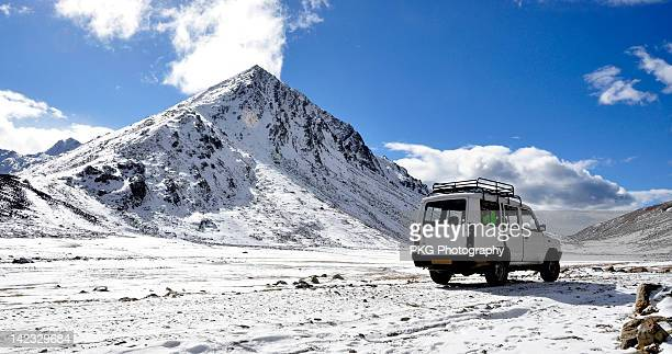 Jeep in snow mountian