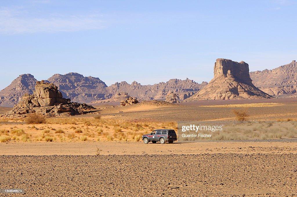 Jeep in the hamada desert, Acacus Mountains, Sahara, Libya