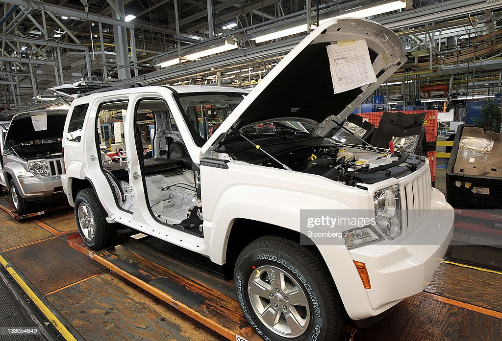 A Jeep Liberty moves down the production line at Chrysler's Toledo Assembly Complex in Toledo, Ohio, U.S., on Wednesday, Nov. 16, 2011. Chrysler Group LLC said it will invest $1.7 billion to update a Jeep sport-utility vehicle and add a second shift at its factory in Toledo in the third quarter of 2013. Photographer: Jeff Kowalsky/Bloomberg via Getty Images