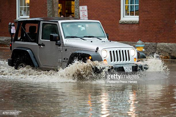 Jeep makes its way through heavy water at the corner of Union and Commercial Streets after a downpour created flash floods throughout the city...