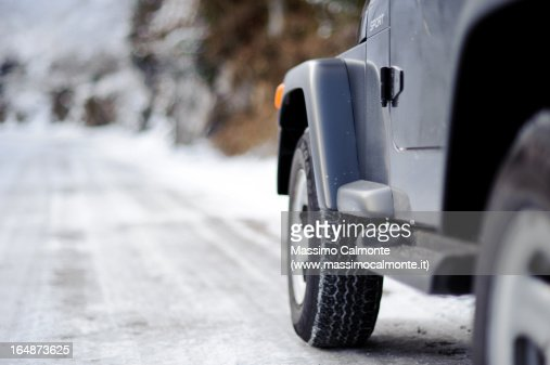 Jeep off-road vehicle on a snowy mountain