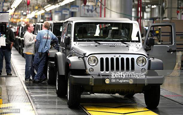 Jeep Wranglers prepare to come off the line after undergoing assembly at the Chrysler Toledo North Assembly Plant Jeep May 7 2014 in Toledo Ohio Fiat...