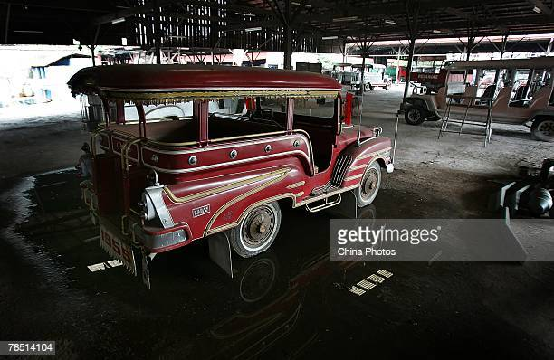 A Jeepney made from a US military jeep left over from World War II is seen in the Sarao workshop on August 24 2007 in Manila Philippines Jeepneys a...