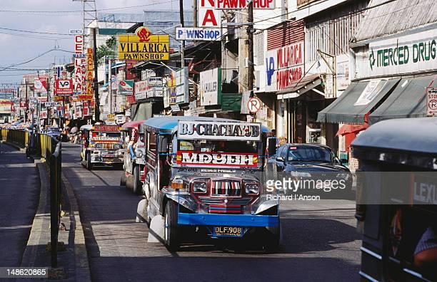 Jeepney on city street in downtown Manila.
