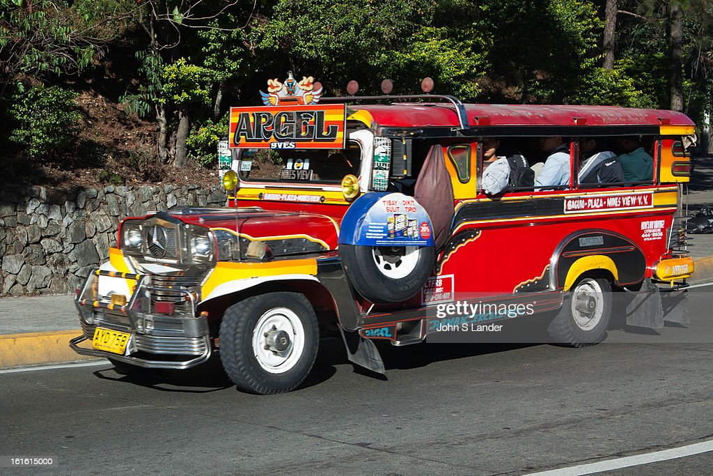 BAGUIO, BENGUET, PHILIPPINES - : Jeepneys are a popular means of public transportation in the Philippinesand were originally made of abandoned US army jeeps left behind from World War II. Jeepneys are known for flamboyant decorations and funny names given by their owners such as 'One Love'. They have become almost a symbol of Filipino culture and ingenuity. The word Jeepney derives from a combination of jeep and jitney. At the end of WWII jeepneys were stripped down, metal roofs were added for shade; and they were decorated with vibrant colors and ornaments. Jeepneys reestablished public transportation in the Philippines which had been destroyed during the war..