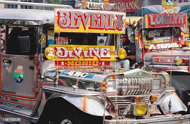 Jeepneys waiting for passengers outside market.