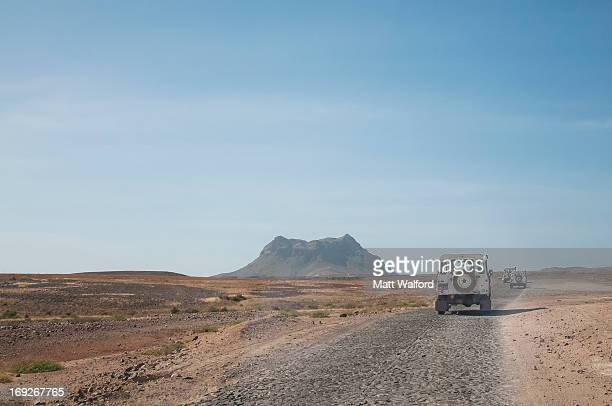 Jeeps driving in dusty landscape