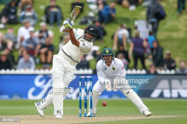 Jeet Raval of New Zealand bats while Quentin de Kock of South Africa looks on during day three of the test match between New Zealand and South Africa...