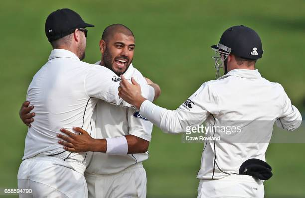 Jeetan Patel of New Zealand is congratulated on taking the wicket of Hashim Amla of South Africa during day four of the Test match between New...