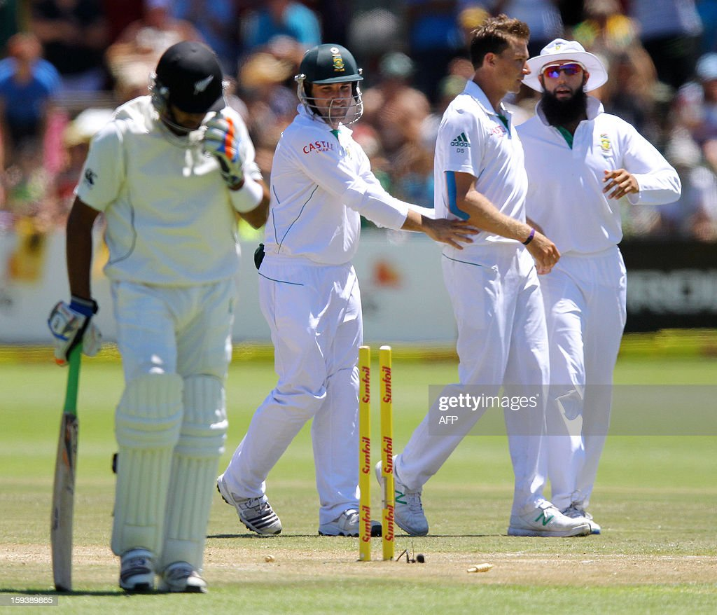 Jeetan Patel of New Zealand walks off after losing his wicket on the third day of the second and final test match between South Africa and New Zealand at the Axxess St George's Cricket Stadium on January 13, 2013 in Port Elizabeth. AFP Photo / Anesh Debiky