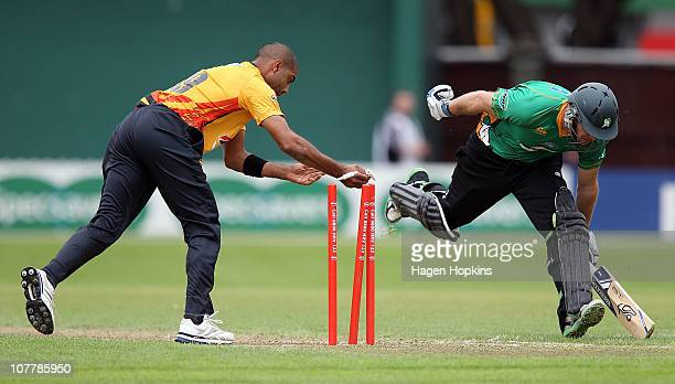 Jeetan Patel of the Firebirds knocks the bails off as Jamie How of the Stags makes his ground during the HRV Cup Twenty20 match between the...