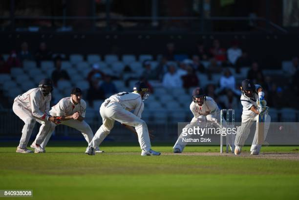 Jeetan Patel of Warwickshire defend a ball during the County Championship Division One match between Lancashire and Warwickshire at Old Trafford on...