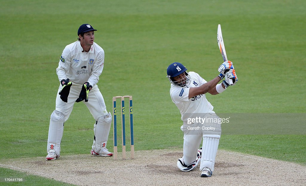 Jeetan Patel of Warwickshire hits out for six runs during day two of the LV County Championship Division One match between Durham and Warwickshire at The Riverside on June 13, 2013 in Chester-le-Street, England.