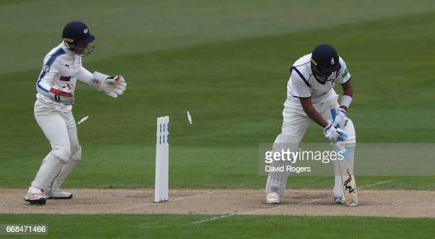 Jeetan Patel of Warwickshire is bowled by Adil Rashid during the Specsavers County Championship One match between Warwickshire and Yorkshire at...