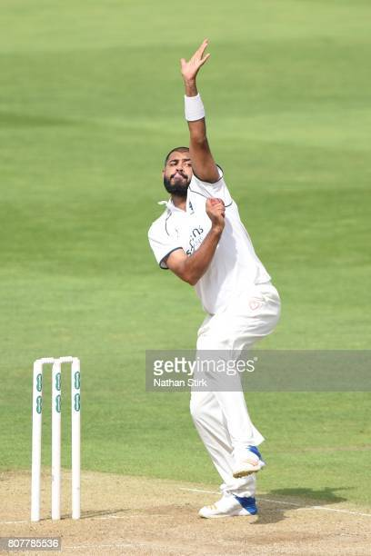 Jeetan Patel of Warwickshire runs in to bowl during the Specsavers County Championship Division One match between Warwickshire and Middlesex at...